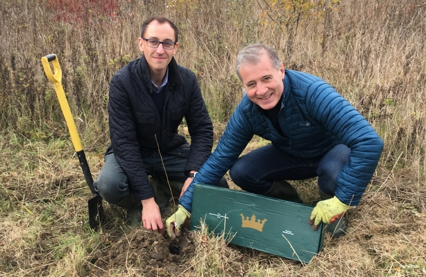 Mark Pawsey & Yousef Dahmash planting in Queen's Diamond Jubilee Wood